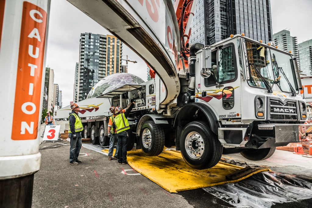 operators maintaining the pump truck on site - Brundagebone